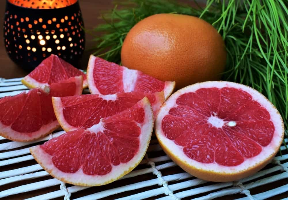 Whole and slices of flame grapefruit