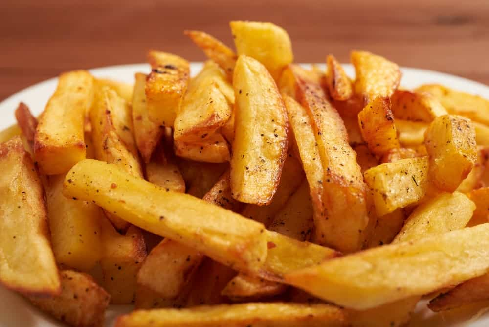 A plate of French fries.