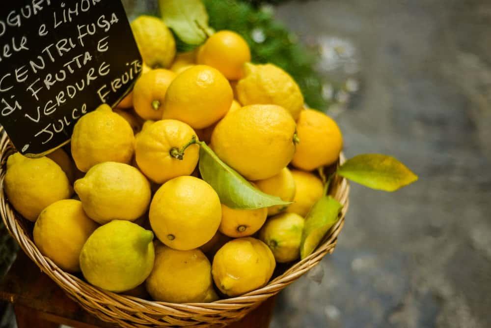 A basket of Genoa lemons on display at a market.