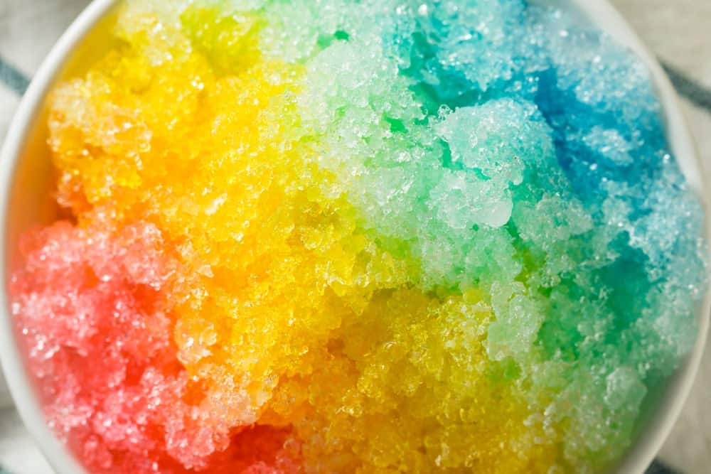 Close up of a Hawaiian-based shaved ice in multi colors.