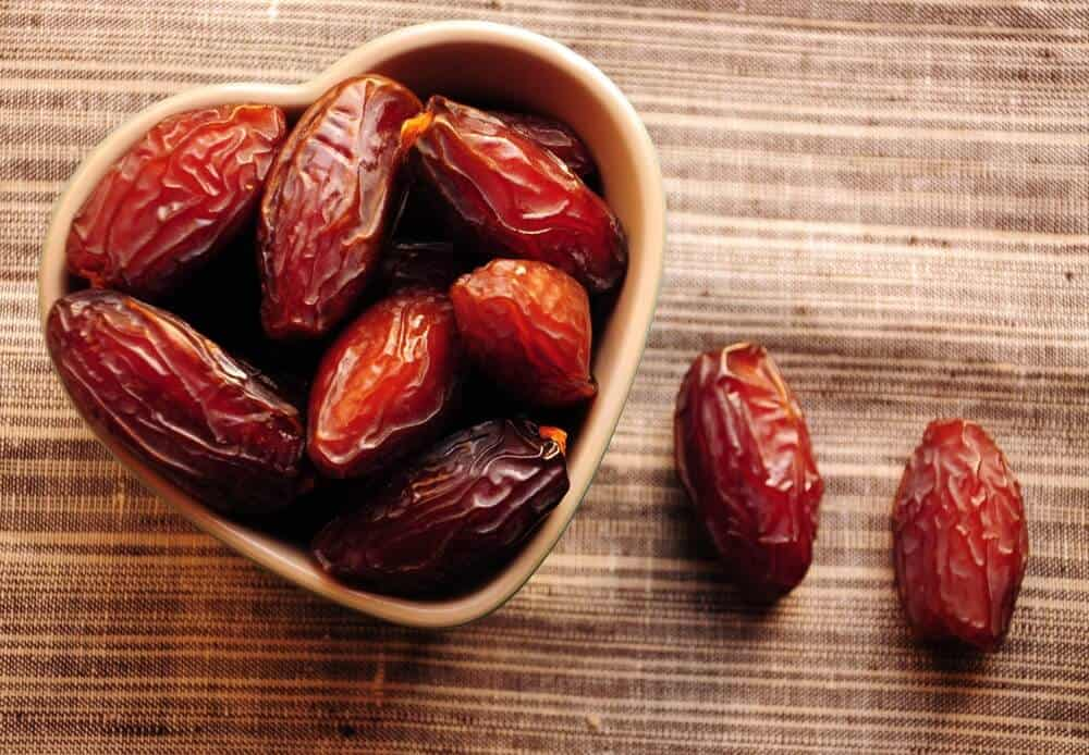 Dates served on a heart-shaped bowl.