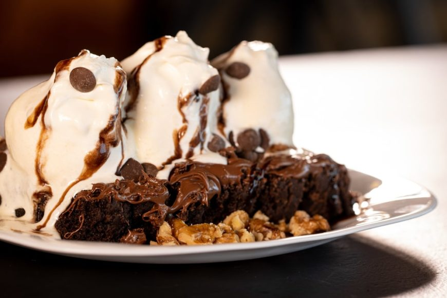 A hot fudge pudding cake with ice cream topping.