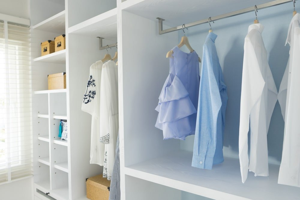 A look at a white built-in wooden closet.
