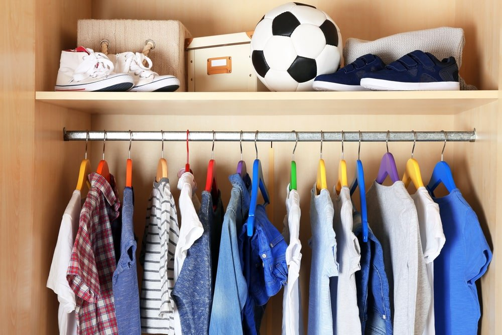 A close look inside a boy's reach-in closet.