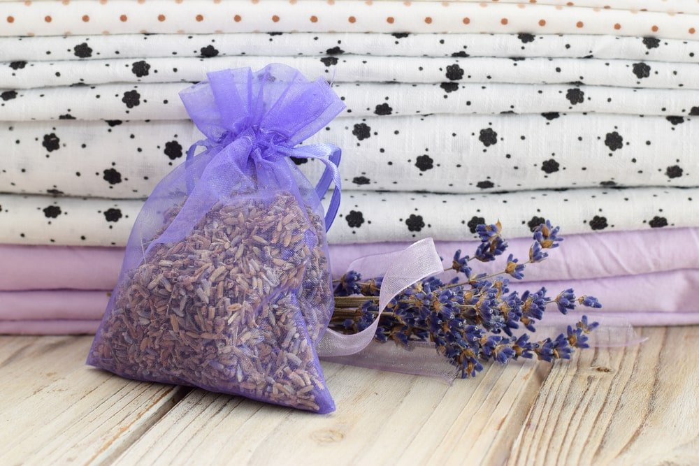 A bag of dried lavender flowers stored with the bed sheets.