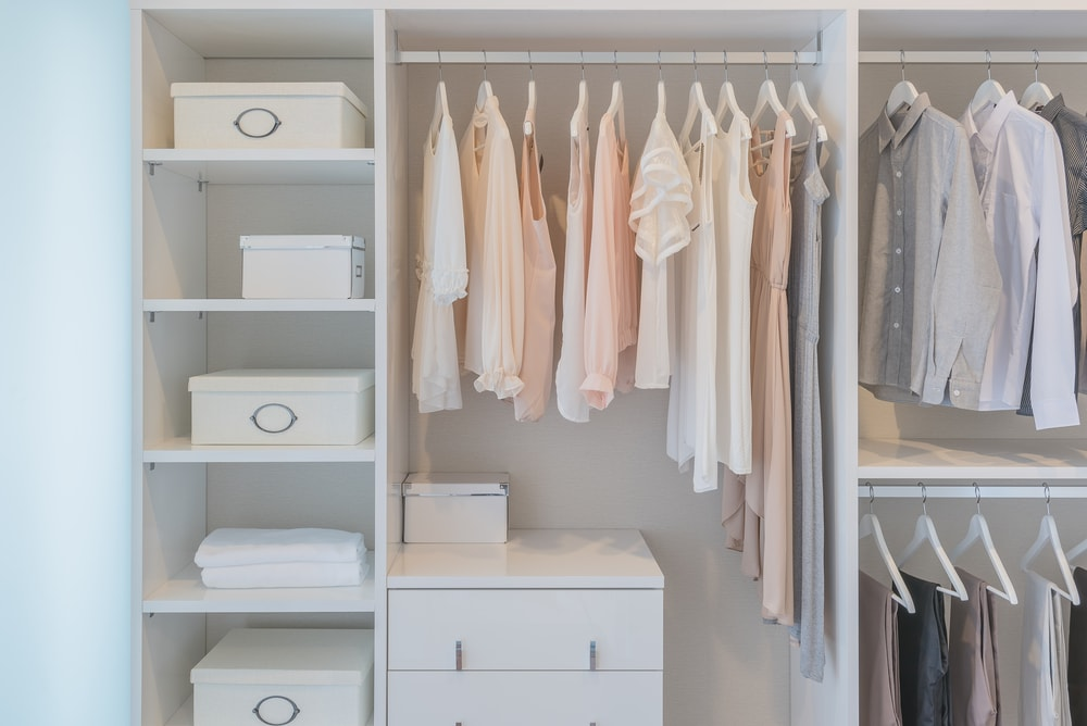 A look at the bright closet with bilt-in racks, shelves and cabinets.