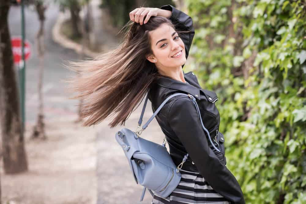 A girl flaunting her smooth and healthy hair.