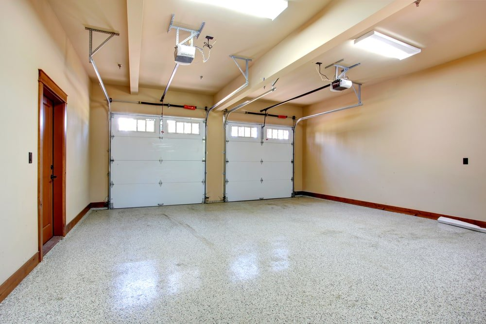 A look at a two-car garage with beige walls and ceiling.