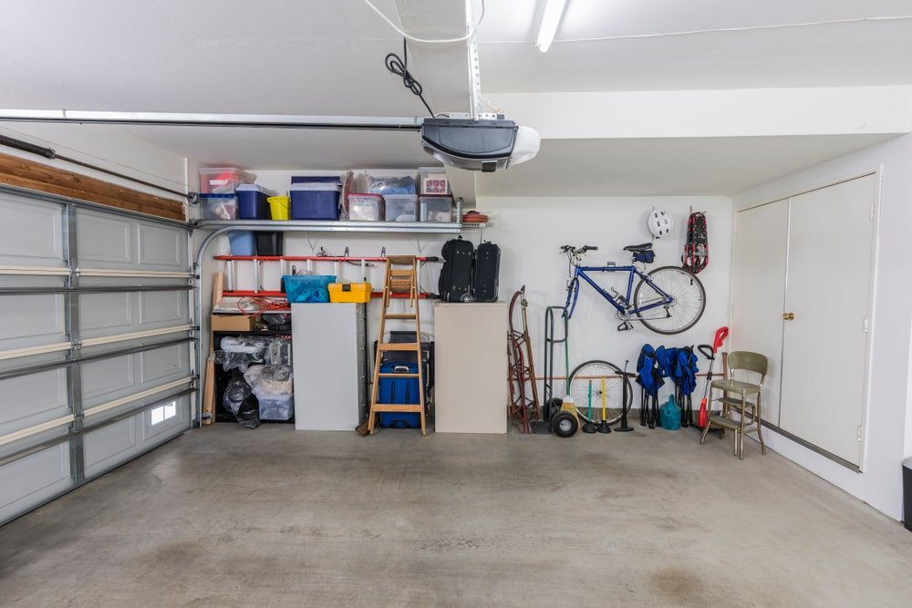 A look at a bright and white garage that has a storage area on the far side.