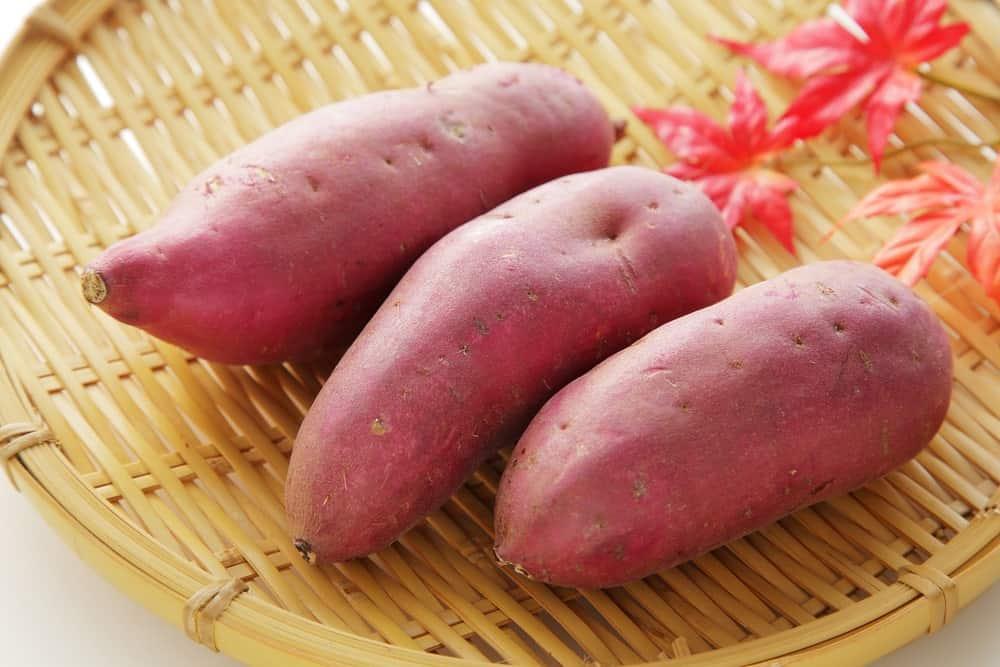 Japanese sweet potatoes on a wicker plate.