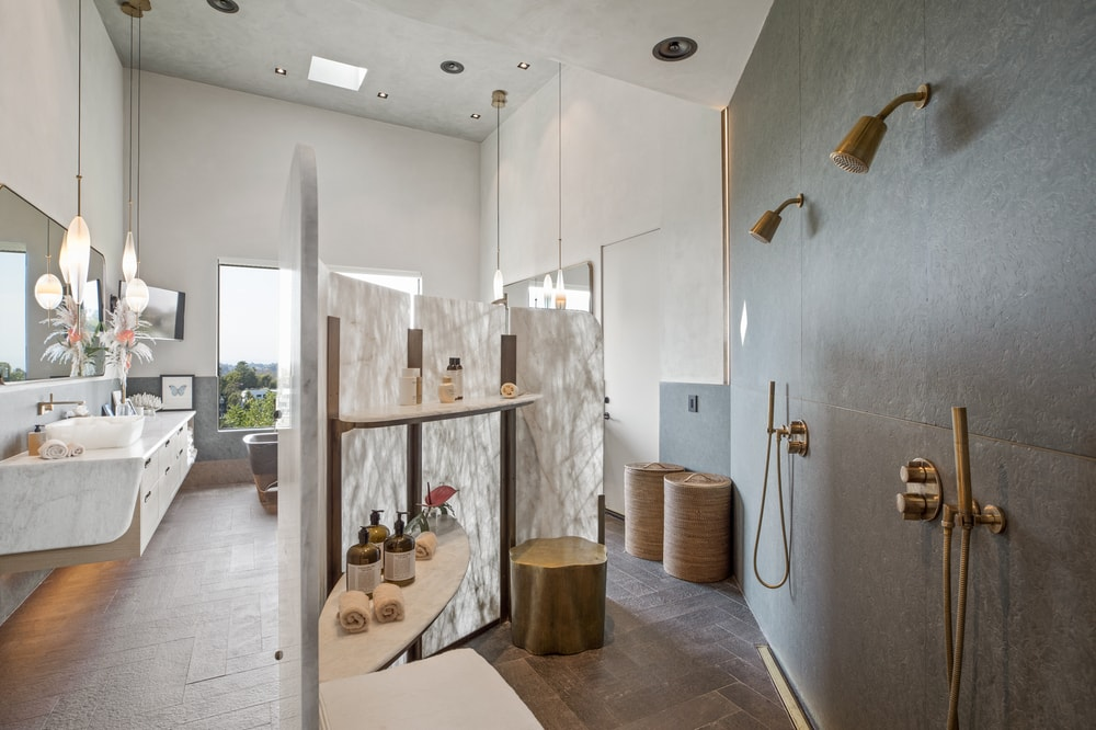 On the side of the bathroom is this large walk-in shower area separated from the rest of the bathroom with a simple wall of glass. Image courtesy of Toptenrealestatedeals.com.