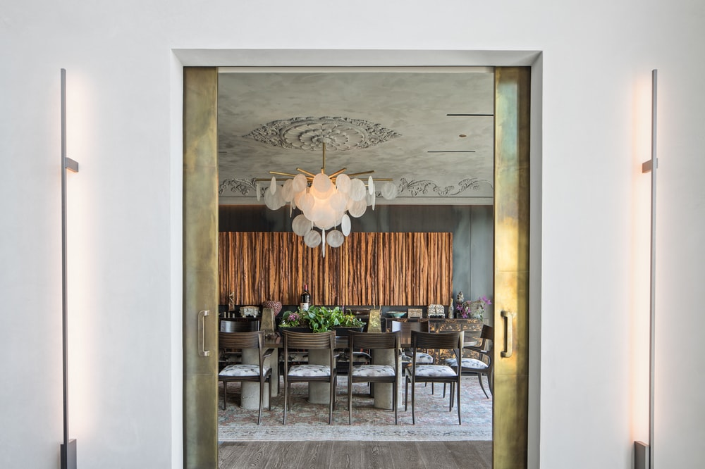 This is the hallway leading to the dining area with a golden set of doors. Image courtesy of Toptenrealestatedeals.com.