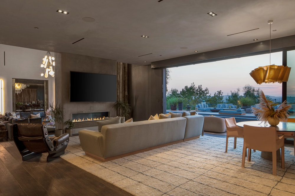 This family room leads to the outdoor area through a set of glass doors that open up the area to the exteriors. Image courtesy of Toptenrealestatedeals.com.