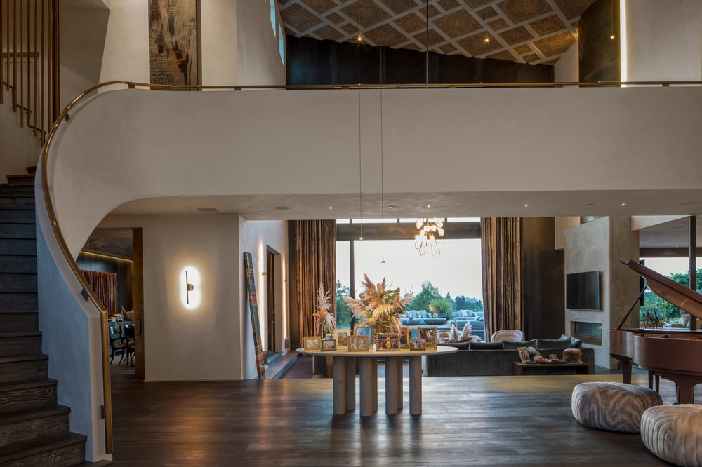 This angle of the foyer gives a closerlook at the table in the middle of the hardwood flooring leading to the living room on the far side. Image courtesy of Toptenrealestatedeals.com.