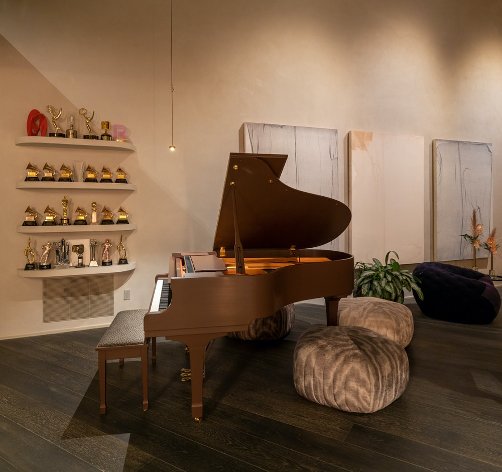 This is a closer look at the grand piano of the foyer. It has a dark brown tone that matches well with the flooring and walls. Image courtesy of Toptenrealestatedeals.com.