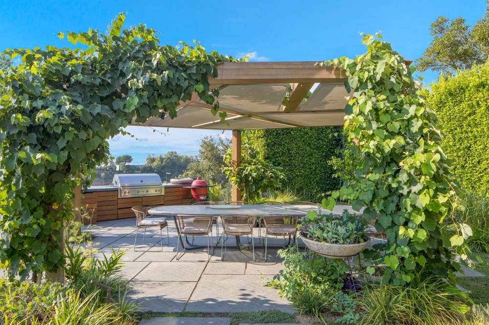 The pergola is fitted with an alfresco dining area as well as a grilling station on the far side. Image courtesy of Toptenrealestatedeals.com.