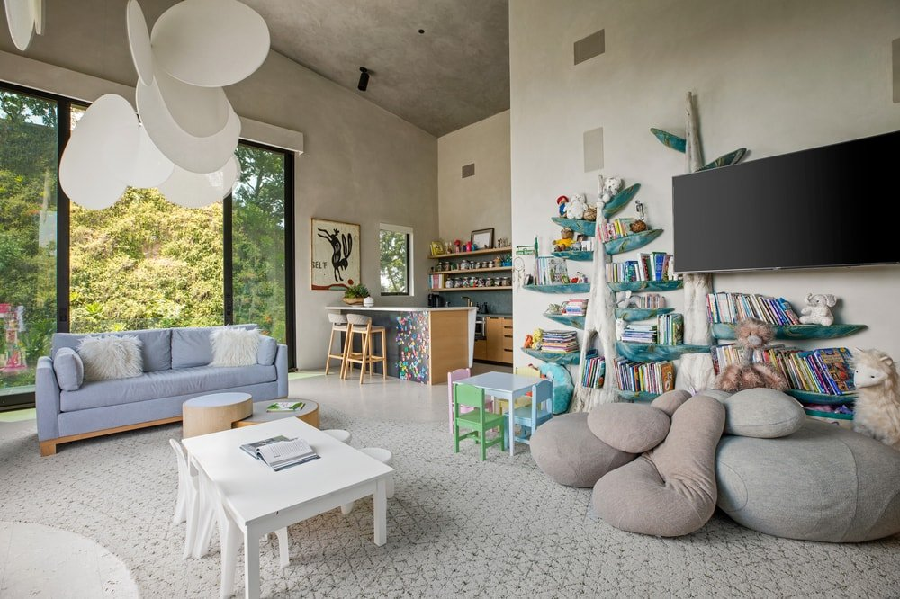 This is the colorful playroom with lots of space for play, crafts and watching TV. Image courtesy of Toptenrealestatedeals.com.