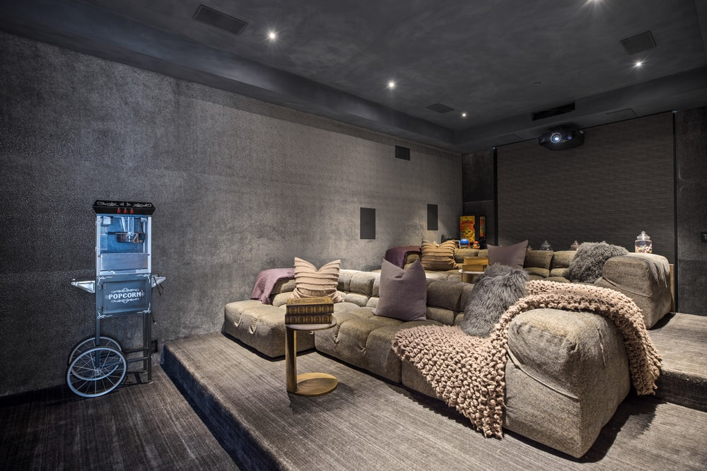 This is another view of the home theater showcasing the comfortable sofas that are placed on ascending platforms. Image courtesy of Toptenrealestatedeals.com.