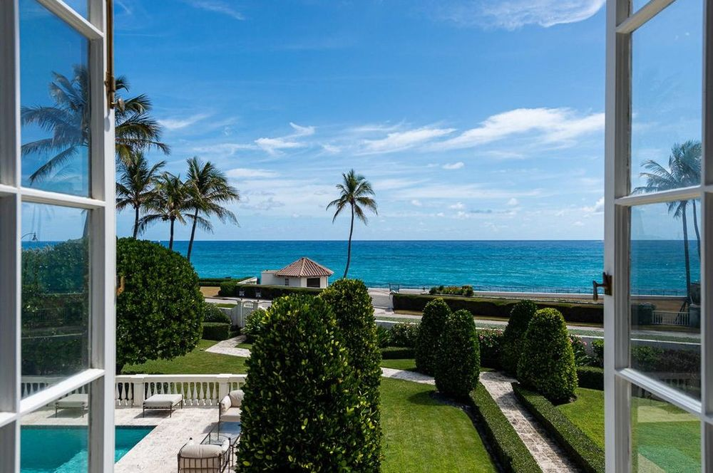 This is the view as seen from the vantage of the second floor window. You can see here the landscaping of the shrubs and grass lawns as well as the view of the ocean. Image courtesy of Toptenrealestatedeals.com.