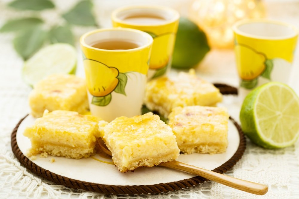 Slices of key lime pie bars on a plate.