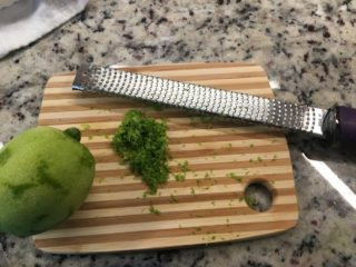 The zest of the lime is grated from the lime.
