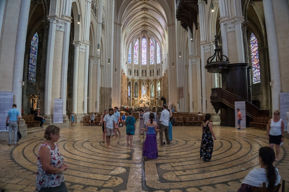 People walking inside the Labyrinth of the Cathedral of Chartres.