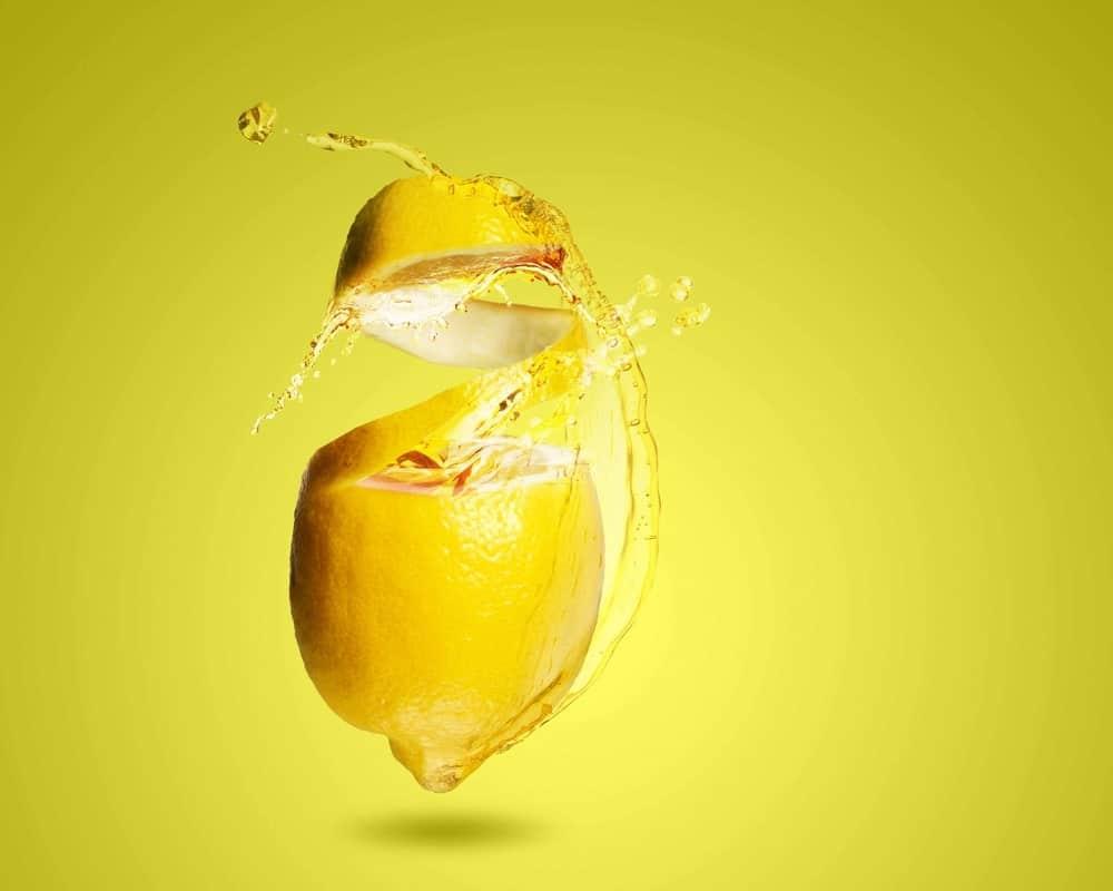 Lemon zest concept on yellow background.