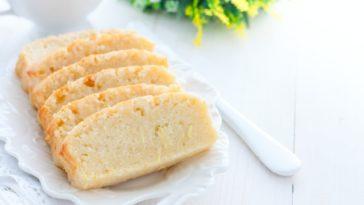 Slices of freshly-baked lemon zucchini bread on a white plate.