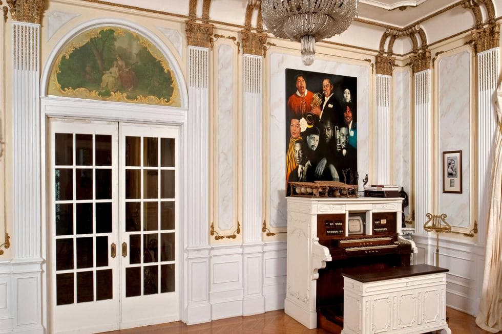 This is a close look at the music room with a vintage organ at the corner beside the French Doors. Image courtesy of Toptenrealestatedeals.com.
