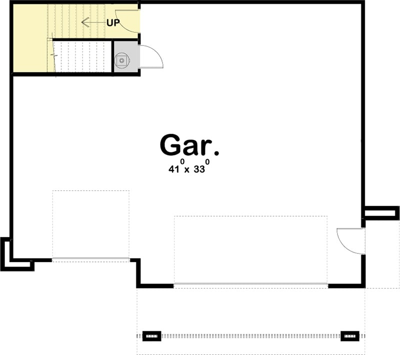 Main level floor plan of a 1-bedroom two-story modern carriage apartment with a 3-car garage that has enough room for a workshop.