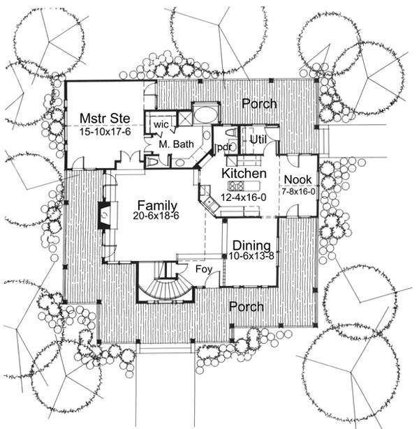 Main level floor plan of a 3-bedroom two-story country style The Liberty Hill home with a wraparound porch, family room, primary suite, formal dining room, and kitchen with breakfast nook.