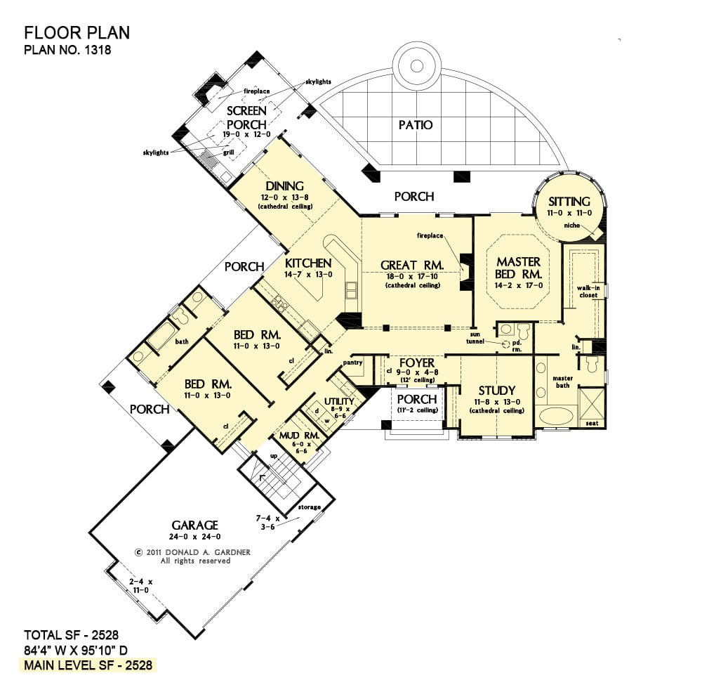 Main level floor plan of a single-story 3-bedroom The Keaton Rustic ranch with angled garage, study, great room, kitchen, dining that opens to the screened porch, two bedrooms, and a primary suite with circular sitting room and private access to the rear porch.