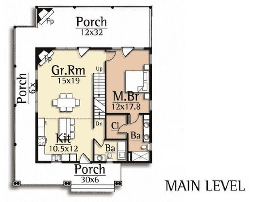 Main level floor plan of a two-story 5-bedroom craftsman style home with a wrap-around porch, kitchen, great room, powder room, and a primary suite.