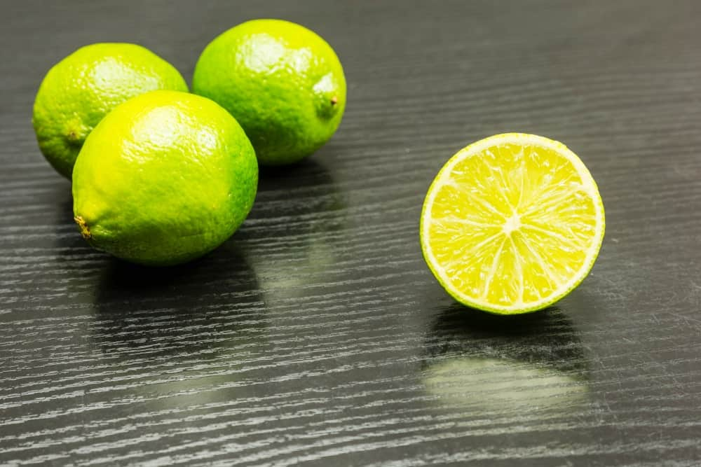 Omani limes on wooden countertop.