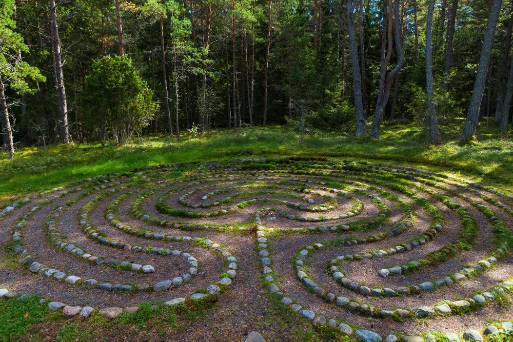An oriental stone labyrinth in a forest.