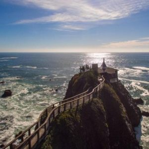 This is an aerial view of the house showcasing the unique landscape of the cliff it is perched on. You can also see here the long walkway that leads to the mainland. Image courtesy of Toptenrealestatedeals.com.