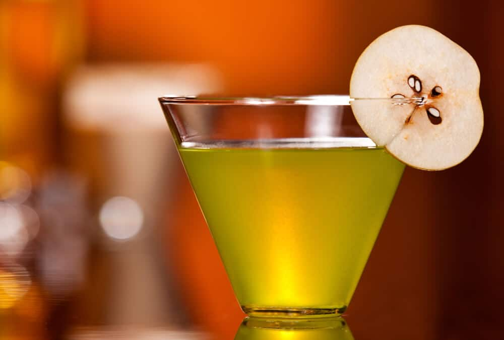 A green pear martini with a real pear garnish.
