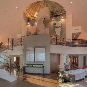 This is the two-story great room of the penthouse starting with a foyer, a set of stairs and the living room areas. Image courtesy of Toptenrealestatedeals.com.