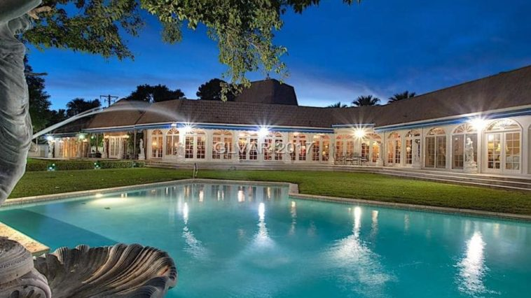 This is a look at the back of the mansion from the vantage of the pool. You can see here that it has rows of glass doors that open the interiors to the backyard pool area. Image courtesy of Toptenrealestatedeals.com.