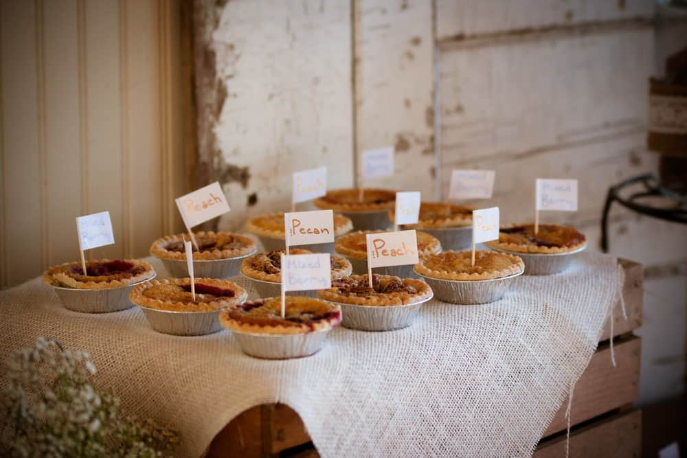 Pies on a decorated table during a wedding reception.