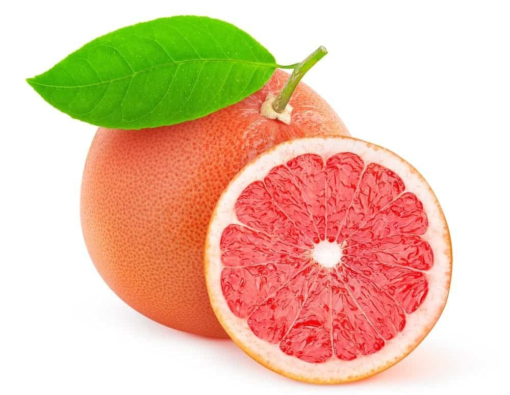 A whole and a half slice of pink grapefruit against white background.