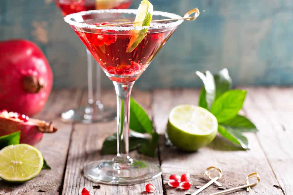 Pomegranate martinis served on clear cocktail glasses.