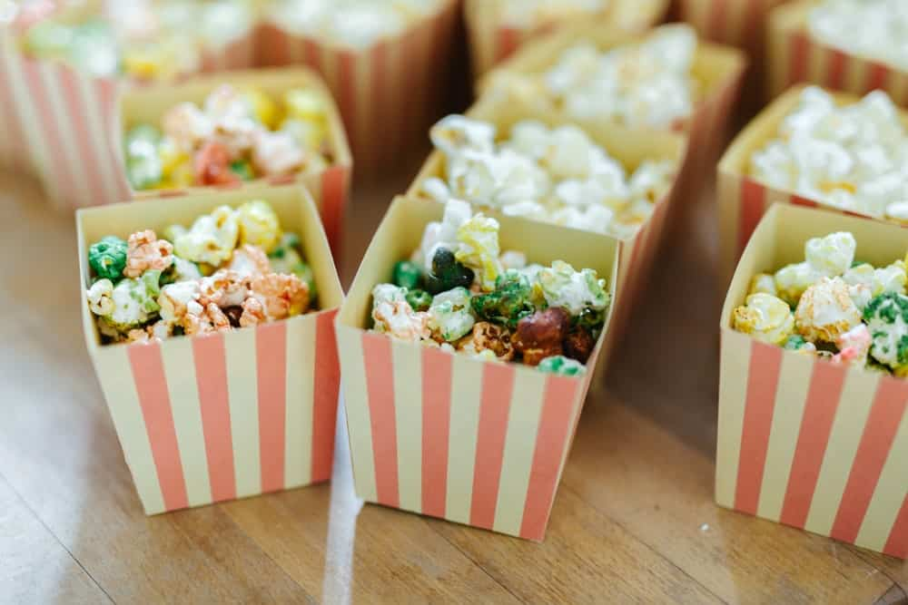 Small boxes of popcorn on a wedding ceremony.