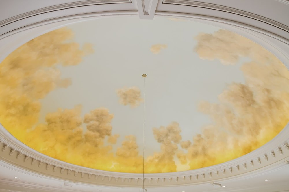 This is a closer look at the dome ceiling of the foyer adorned with a mural of the sky. Image courtesy of Toptenrealestatedeals.com.