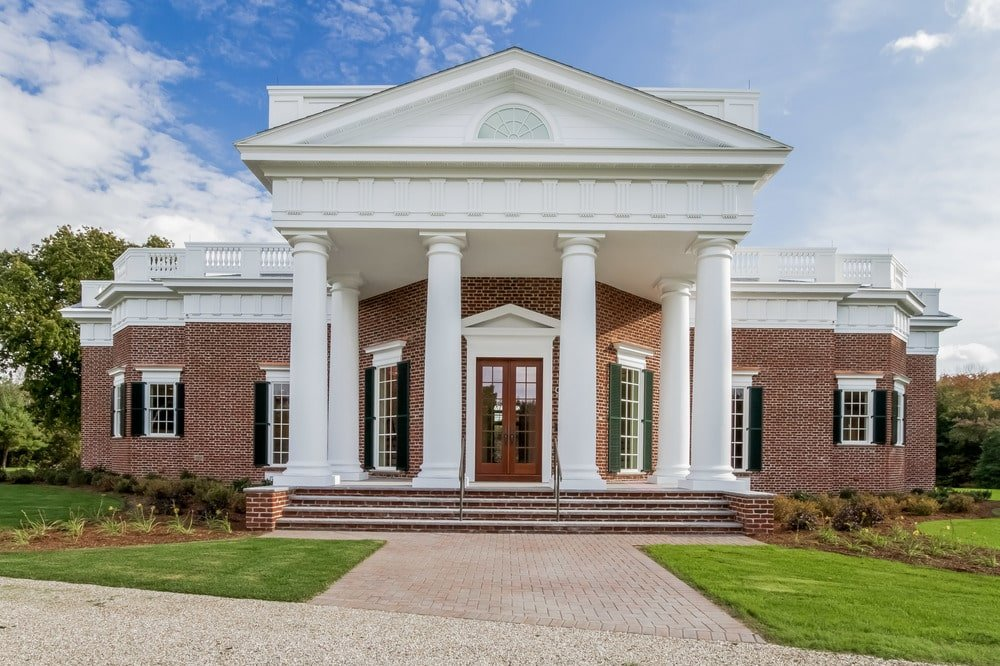 This is a closer look at the main entrance of the house with towering white pillars to support the tall ceiling. Image courtesy of Toptenrealestatedeals.com.