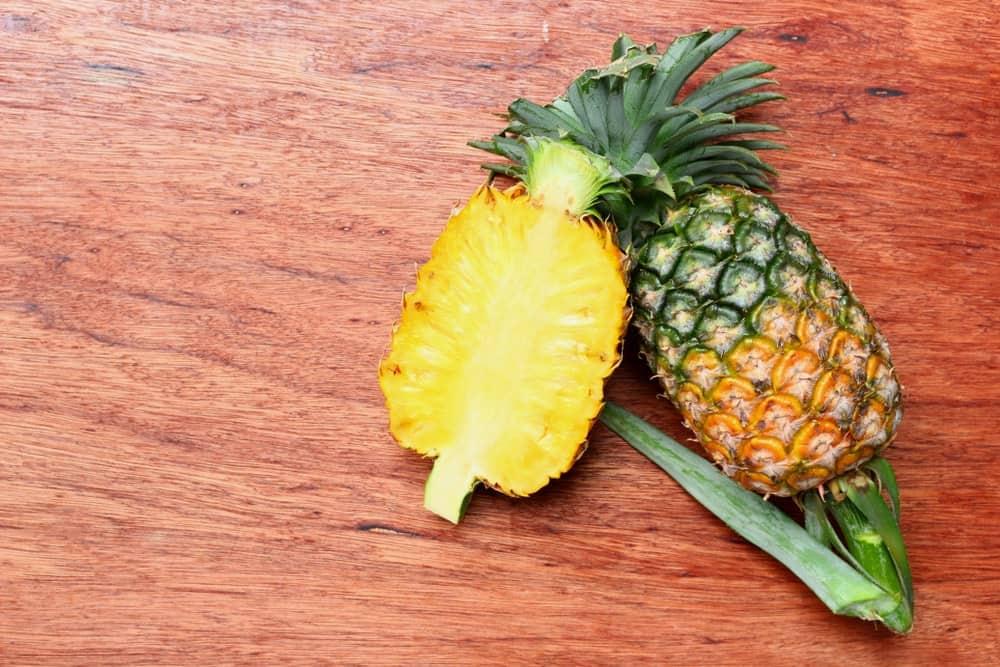 Queen pineapple cut in half.