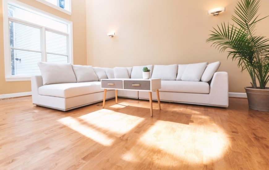 A bright and airy living room with a large L-shaped sectional sofa.