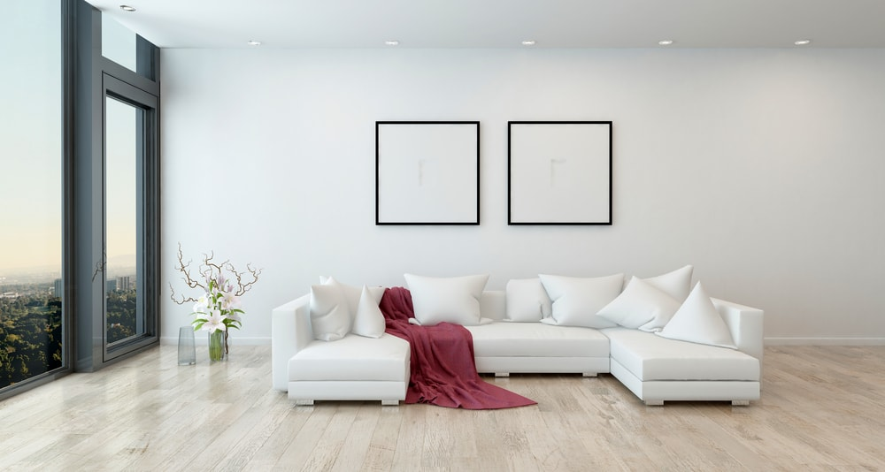 This is a bright living room complemented by the white sectional sofa.