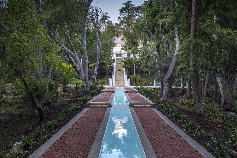 This is a look at the Persian garden of the property that can be enjoyed walking on the terracotta walkways flanking a water feature. Image courtesy of Toptenrealestatedeals.com.
