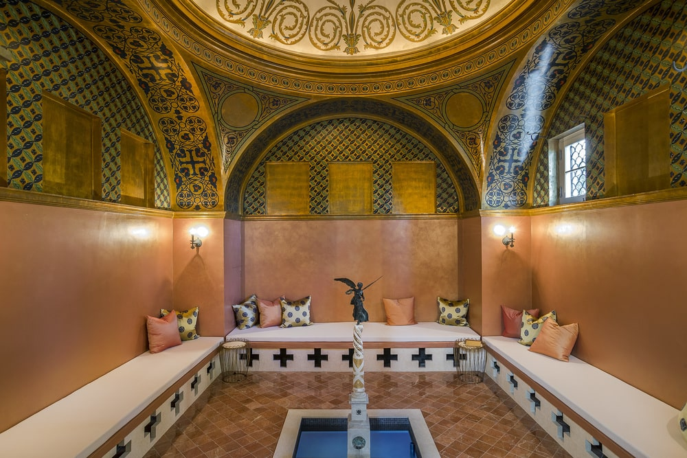 This is the Byzantine-style sitting room with brilliant golden accents and details augmented with a domed ceiling. Image courtesy of Toptenrealestatedeals.com.